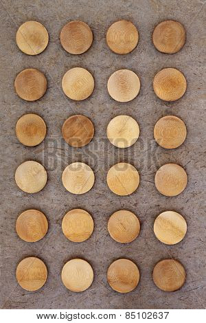 Round wooden bowls over grunge flecked background.