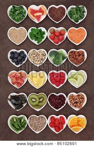 Large selection of diet detox super food in heart shaped porcelain bowls.