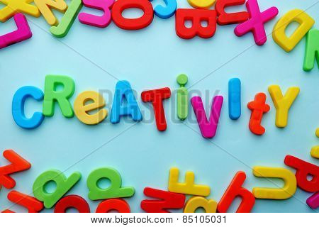Creativity motto by alphabet letters on colorful background