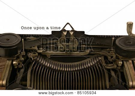 An old fashioned typewriter with the words Once upon a time. Closeup of the antique machines ribbon and carriage.