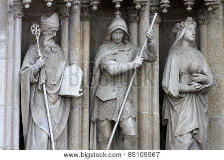 ZAGREB, CROATIA - SEP 25: Saints Methodius, George, Barbara on the portal of the cathedral dedicated to the Assumption of Mary and to kings Saint Stephen and Saint Ladislaus in Zagreb on Sep 25, 2013.