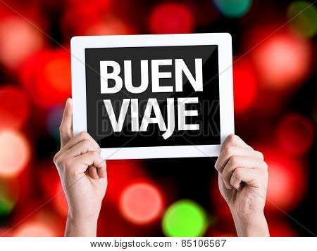Tablet pc with text Have a Good Trip (in Spanish) with bokeh background