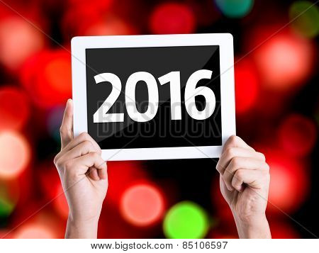 Tablet pc with text 2016 with bokeh background