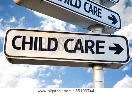 Child Care direction sign on sky background