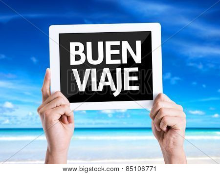 Tablet pc with text Have a Good Trip (in Spanish) with beach background