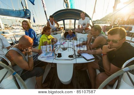 PATRAS, GREECE - CIRCA OCT, 2014: Unidentified sailors on skipper's briefing in the yacht wardroom during sailing regatta 12th Ellada Autumn 2014 among Greek island.
