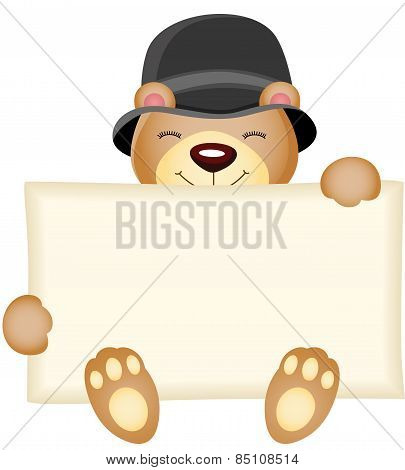 Cute teddy bear holding a blank sign