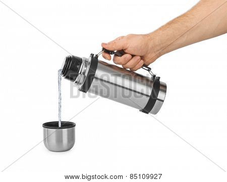 Hand and thermos flask isolated on white background