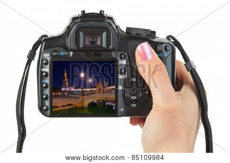 Camera in hand and Sevilla Spain view (my photo) isolated on white background