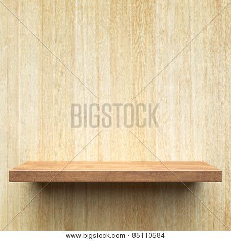 Empty shelf on a wooden wall