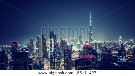 Beautiful Dubai cityscape, bird's eye view on a night urban scene, modern city panoramic landscape, United Arab Emirates