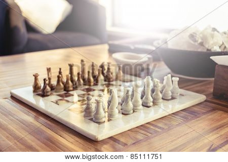 Stone chess game on a wooden table