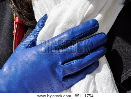 Female blue weather glove and white scarf