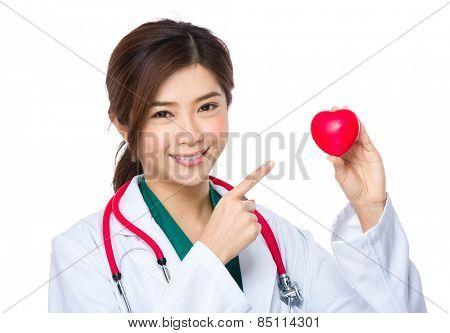 Female doctor finger point to heart ball