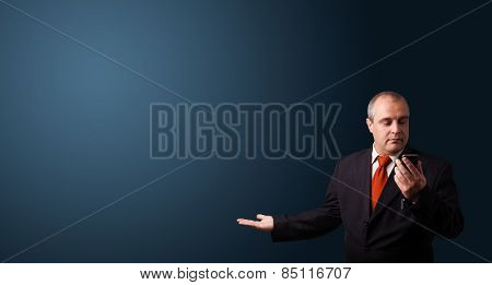 businessman in suit making phone call and presenting copy space