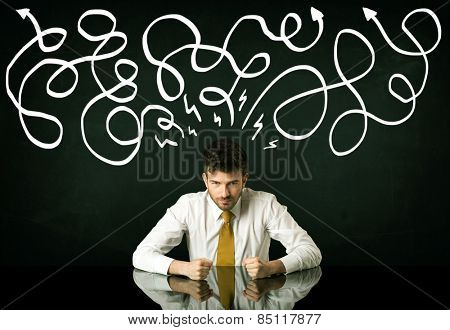 Depressed businessman sitting under white drawn direction lines
