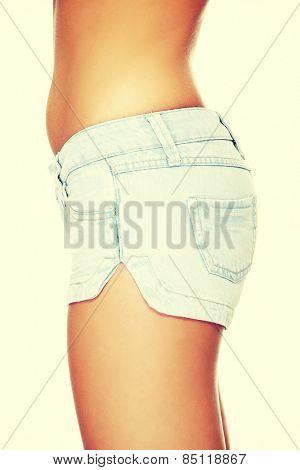 Slim caucasian woman in short trousers.