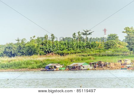 PHNOM PENH, CAMBODIA, JANUARY 2, 2013: Small fishermen's settlement and fishing boats on Mekong river