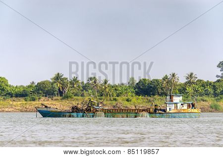 PHNOM PENH, CAMBODIA, JANUARY 2, 2013: A dredger on Mekong river
