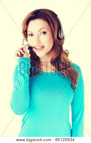 Young smiling call center woman.