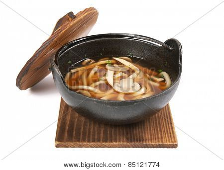 Soup on wood plank, isolated on white background