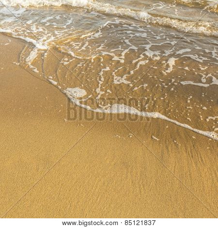 Texture of sand beach sea, soft wave of surf.