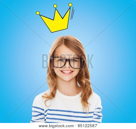 education, school, children and vision concept - smiling little girl with black eyeglasses over blue background with crown doodle