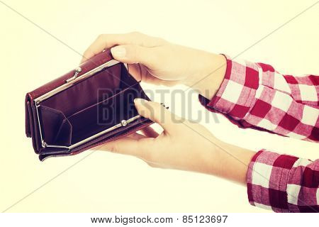 Female hand holding empty wallet.
