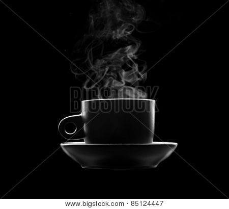 Cup of hot beverage on black