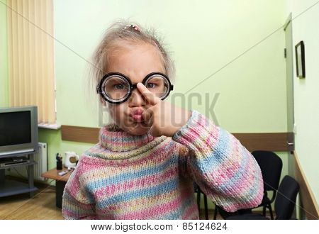 Serious little girl in glasses