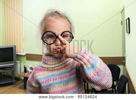 Serious little girl in glasses
