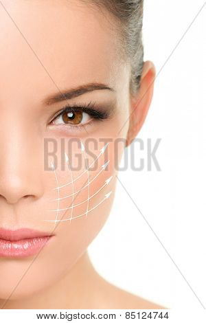 Face lift anti-aging treatment - Asian woman portrait with graphic lines showing facial lifting effect on skin.