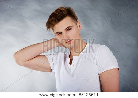Young man suffering from neck pain.