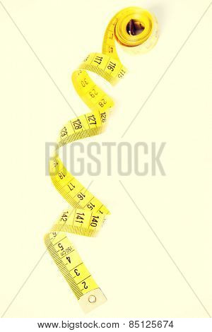 One enrolled yellow measuring tape.