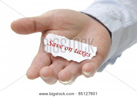 Business man holding save on taxes note on hand