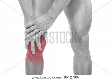 Man holding his painful knee, isolated on white background