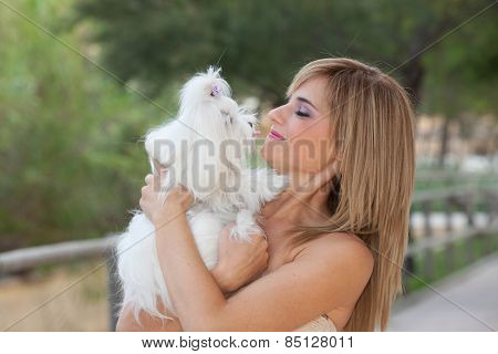 Maltese small long haired dogs with owners
