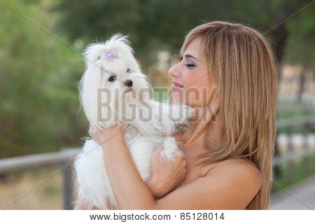 happy woman with pet small maltese dog