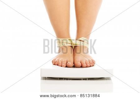 Overweight woman standing on a scale