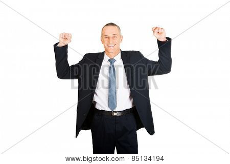 Portrait of successful businessman with arms up.