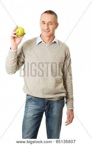 Smiling mature man with an apple.