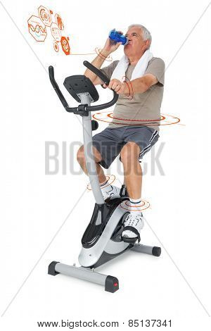 Senior man drinking water on stationary bike against fitness interface