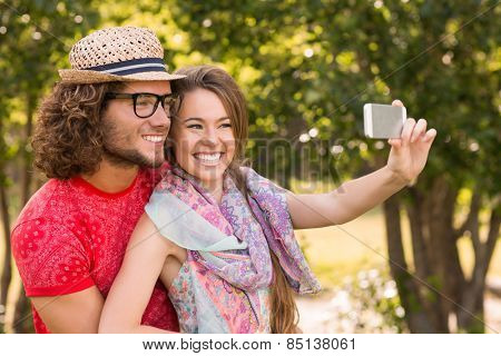 Friends taking a selfie in the park on a sunny day