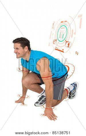 Side view of a sporty smiling man in running stance against fitness interface