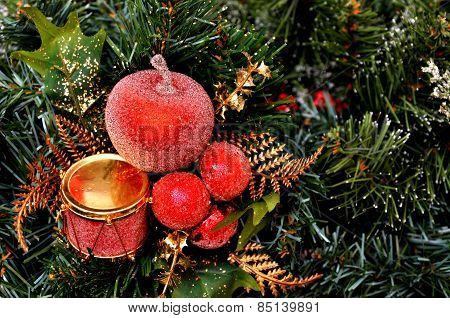 Red Christmas ornament hanging on a Christmas tree