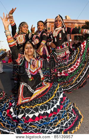 Jaipur, India - March 30, 2009 : women dancing in traditional costume  are celebrating the gangaur festival  in jaipur rajasthan india