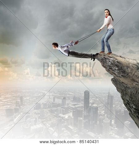 Young man on lead of woman trying to escape