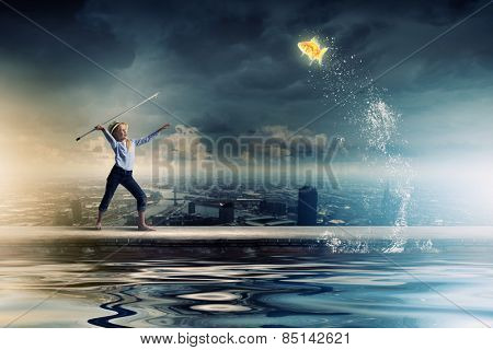 Cute girl fisherman throwing harpoon to catch gold fish