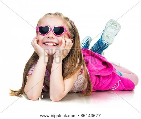 cute  little fashion girl in lying  on a white background