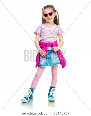 beautiful little fashion girl in gym shoes and skirt on white background